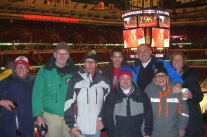 Avenues volunteers take a group to a Blackhawks game